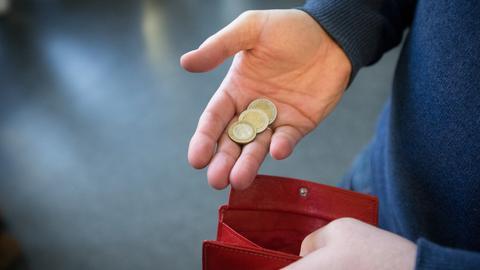 Münzen und Portemonaie