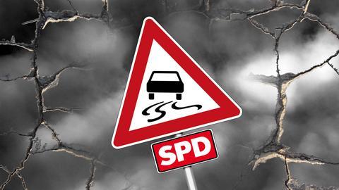"""Ein Verkehrszeichen """"Achtung! Schleudergefahr"""", das zusätzlich mit dem SPD-Schriftzug versehen ist."""
