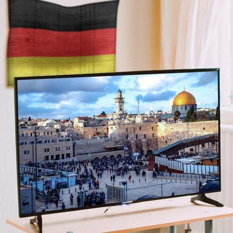Jerusalem auf einem Fernseher, dahinter die Deutschland-Flagge